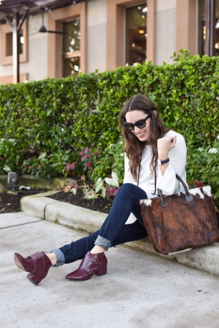 Texas fashion blogger styles a Pinkblush white peplum maternity top with a cowhide bag for fall.