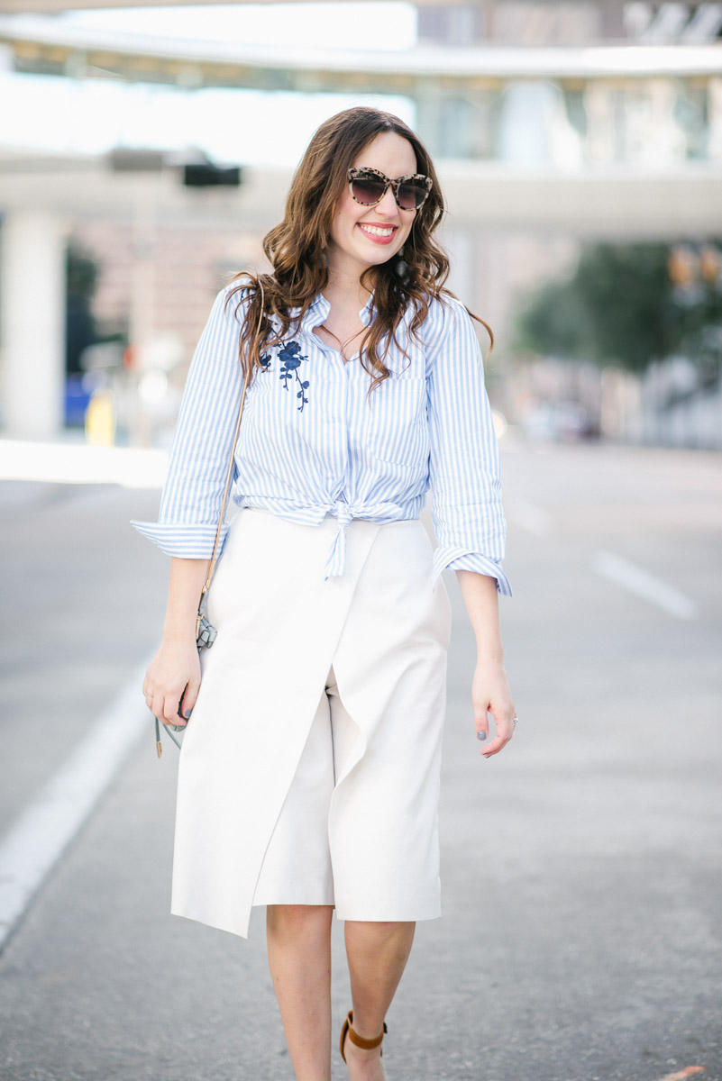 Spring outfit inspiration: tibi's white culottes paired with a striped embroidered button down and steve madden wedges.