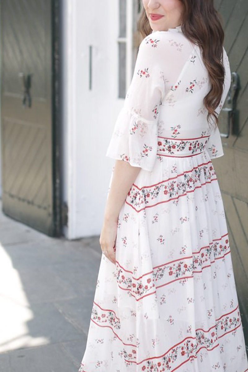 New Orleans fashion in the French Quarter. Blogger styles an Endless Rose red and white maxi dress.