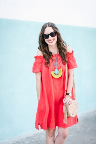 Red off the shoulder anthropolgoie dress styled with a turquoise fringe statement necklace.
